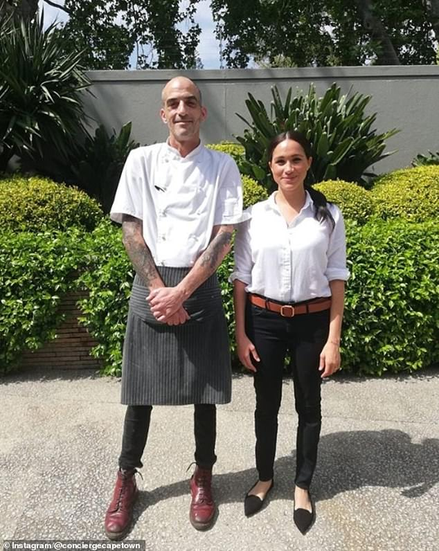 A South Africa-based luxury service company has shared anever-before-seen photo of Meghan Markle taken during the Sussex's 10-day African royal tour in 2019. Pictured, alongside chef, Lee