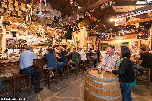 The Birdsville Hotel bar isadorned with memorabilia, from Australian hats and sports badges to tourist photos and licence plates