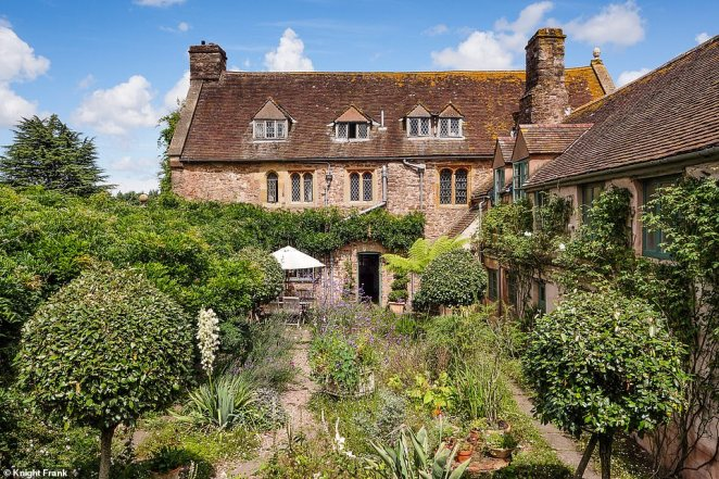 The manor is surrounded by greenery, from immaculately mowed lawns to thick shrubs which breathe life into the historic place