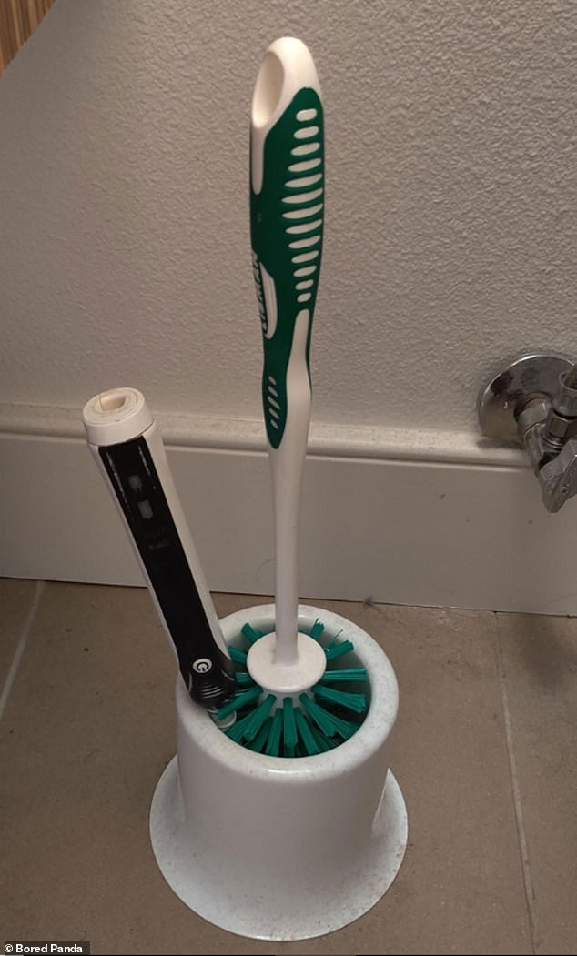an electric toothbrush falls into a toilet brush holder