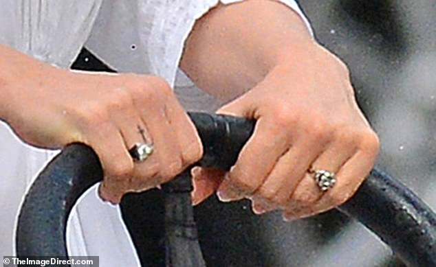 Betrothed? The 45-year-old New Englander wore what appeared to be an engagement ring on her left hand, since the Karma Art Gallery director had no wedding band on his left hand