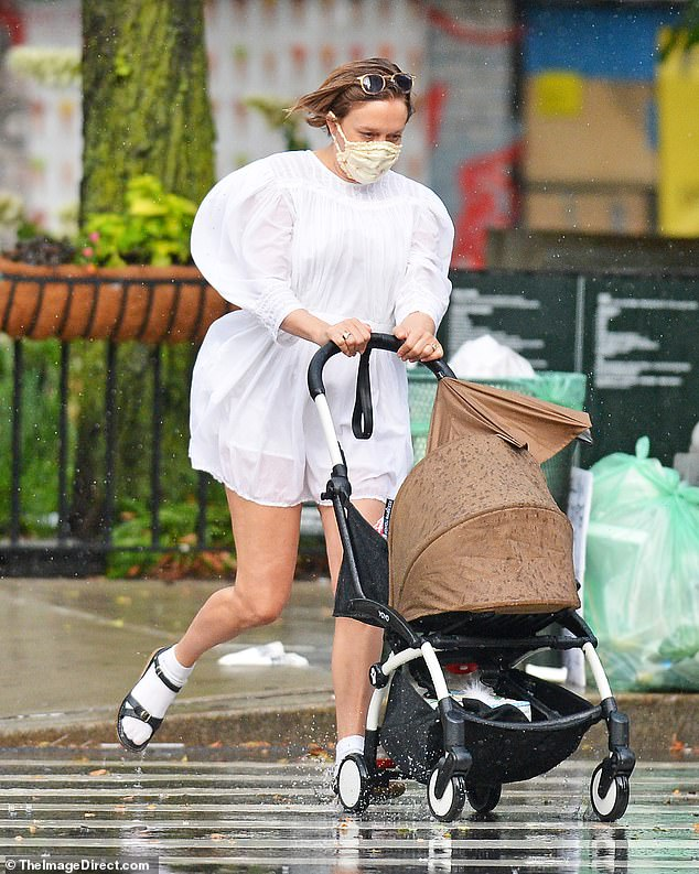 Splash: The new parents both protected themselves with CDC-recommended face masks, but they could not prevent their socks and sandals from getting wet