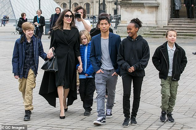 The sighting comes as reports say the pair are getting along much better after agreeing on a new set-up for their children, Maddox, 18; Pax, 16; Zahara, 15; Shiloh, 14; and twins Vivienne and Knox, 11 (pictured with Angie in 2018)