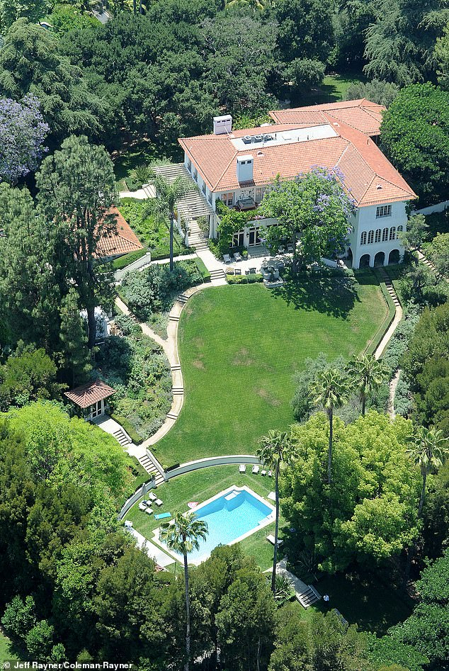 Earlier this month, DailyMail.com revealed new aerial photos that showed how the exes have recently both decked out their homes with swings, slides and trampolines. Pictured: Jolie's $24 million compound