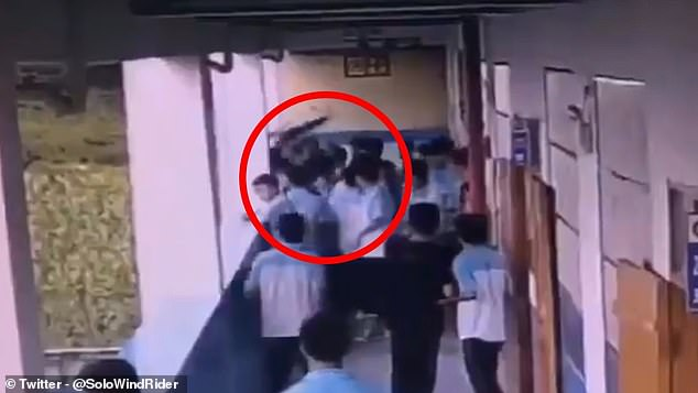 The suspect grabs the victim and throws him down the school building on September 16, 2019
