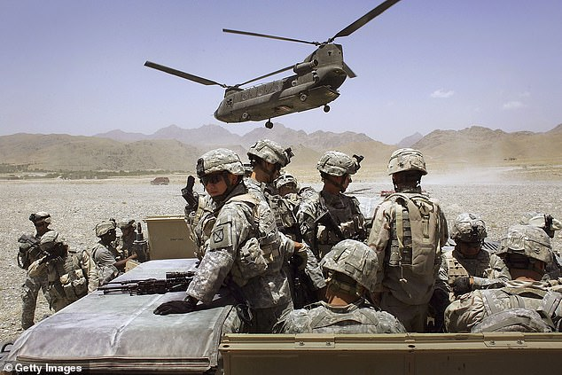 American soldiers from the 10th Mountain Division deploy to fight Taliban fighters as part of Operation Mountain Thrust to a U.S. base near the village of Deh Afghan on June 22, 2006