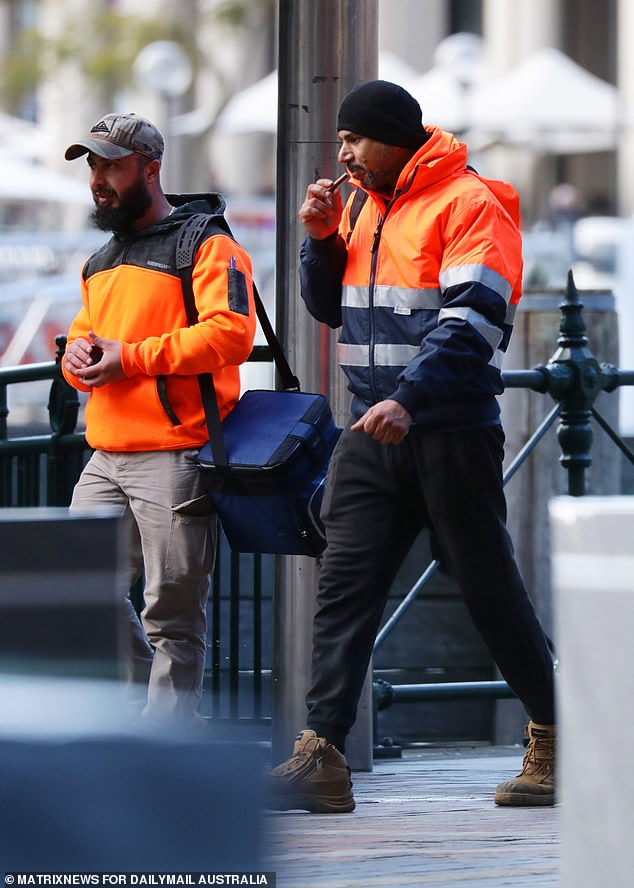 The move has put more cash in casual workers pockets, making them reluctant to return to work, industry insiders say (pictured, tradesmen head to work in Sydney on June 29)