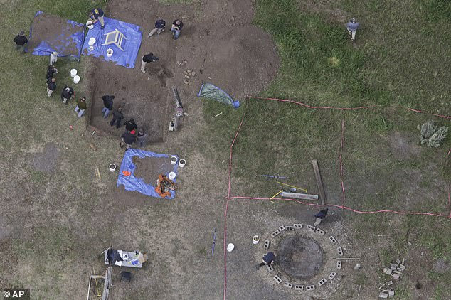 In this aerial photo, investigators search for human remains at Chad Daybell's residence in the 200 block of 1900 East in Salem, Idaho on June 9