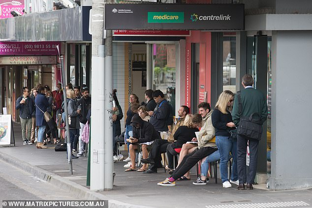 Mr Morrison is also concerned the government is 'burning through' almost $11billion a month on JobKeeper wage subsidies (pictured, queues outside a Melbourne Centrelink)