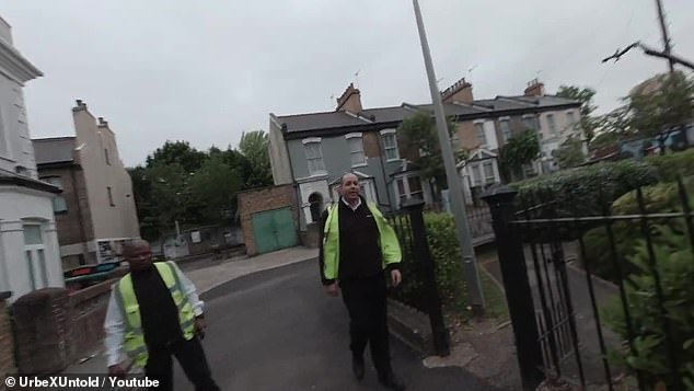 After running away, they are confronted by two security guards, pictured above, and escorted off the site.Production on BBC One's veteran soap came to a halt in March