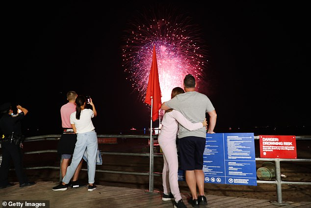 Couples are pictured enjoying the show from Coney Island