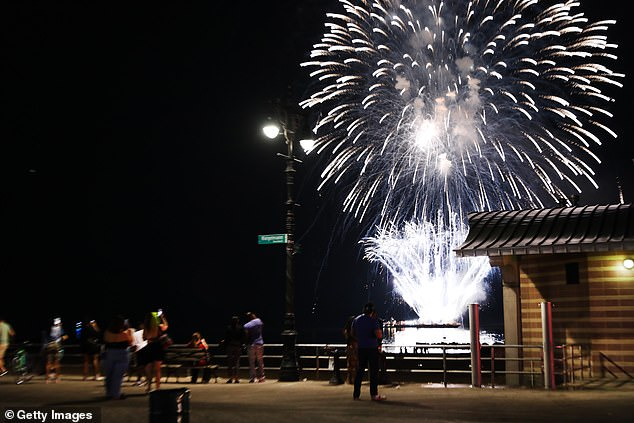 Spectators on the boardwalk in Coney Island also could see fireworks Monday night