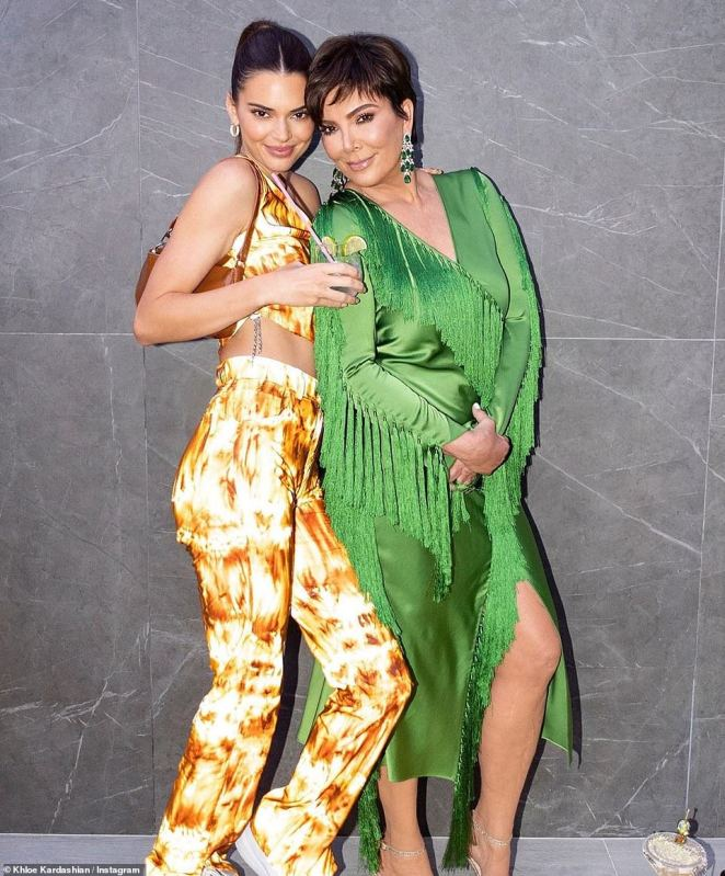 Mother–daughter bonding: Kendall, who lit up the evening with her fire-patterned pants and crop top, posed with her mother Kris Jenner, who glowed in a green stain dress with a high slit and fringe running across her sleeves and front