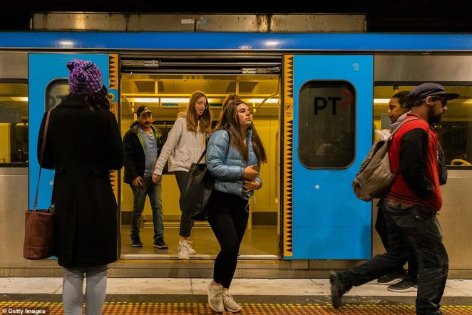 Victorians living inside the locked down suburbs will still be able to attend work and school. Pictured: Commuters getting off a train at Flinders Street Station
