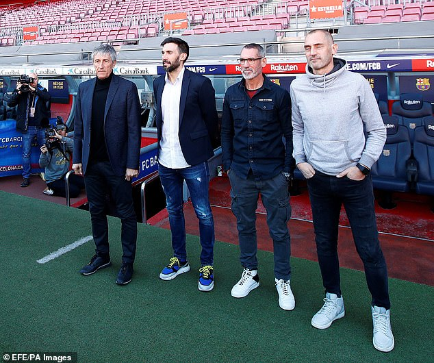 Sarabia (second left) is pictured with Barcelona boss Quique Setien (left) as well as another assistant Jon Pascua (second right) and goalkeeper coach Fran Soto at their January unveiling