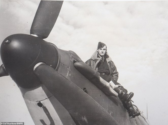 Among the incredible black and white images set to go on sale at with C&T Auctions, of Ashford, Kent, is one image of Squadron Leader Jocelyn Millard sitting on the top of an aircraft with his flight gear