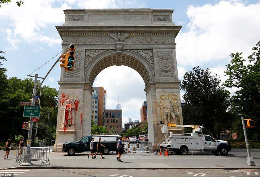 Target: The arch at Washington Square Park has two statues of the nation's first president, which were targeted by vandals throwing balloons in the early hours of yesterday morning