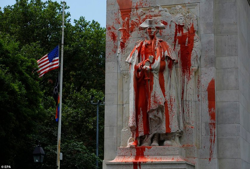 Defaced: A statue of George Washington is covered in red paint after being vandalized in Washington Square Park in the early hours of Monday. America's first president owned more than 100 slaves, making him a target of recent anti-racism protests