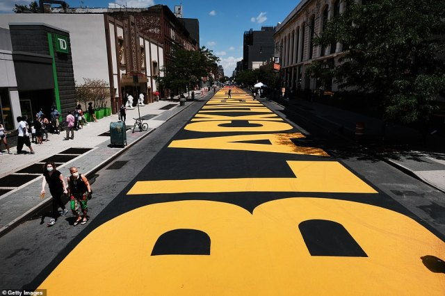 A massive Black Lives Matter mural covers a street in Brooklyn, as seen yesterday, after it was painted over the weekend along the block of Fulton Street between Marcy and Brooklyn avenues