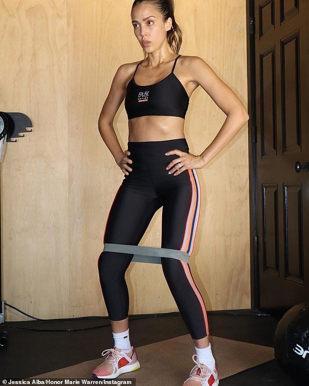 Banded: For her workout she threw an exercise ball and used a fitness band