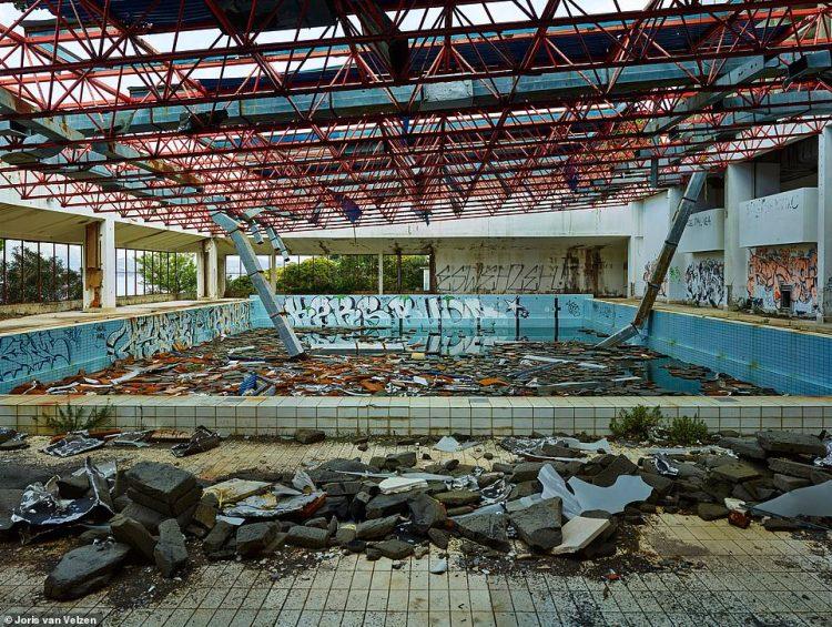 The swimming pool inside one of the abandoned hotels is now filled with debris