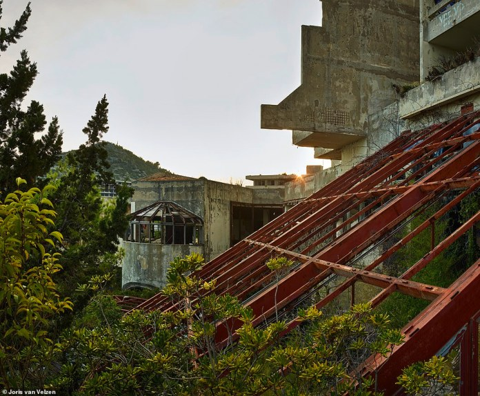 Overgrown trees and plants surround the abandonedGoričina Hotel. Holidaying in Kupari was difficult unless you had military connections