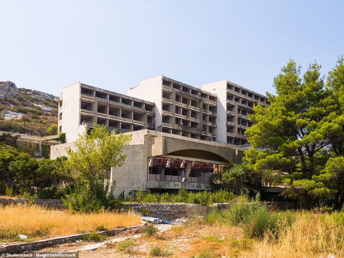 An exterior view of Hotel Goričina, which is slowly being enveloped by trees and bushes
