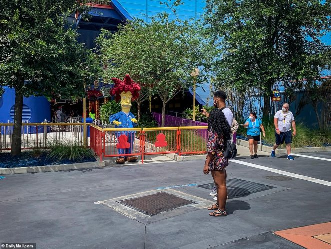 Visitors wanting to take pictures with characters must stand 12-feet away at Universal Studios
