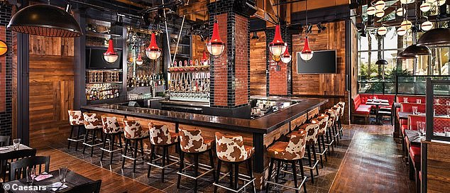 Guy Fieri Vegas Kitchen and Bar (above), co-managed by Harrah¿s, is also accused of failing to properly respond to ensure worker safety when a food runner contracted the virus.