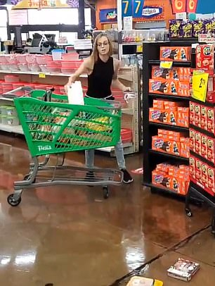 Video from the store shows the woman taking out trays of chicken and meat from her cart and tossing them on the fl