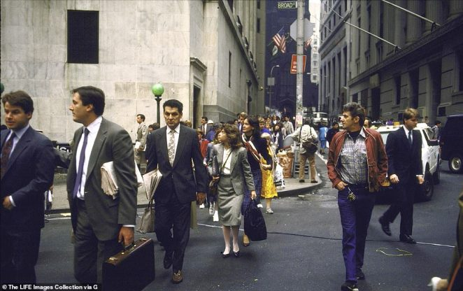 In the 1980s, the stock market made modest gains until the c when markets plunged and Wall Street lost $500 billion. But there was cause for optimism that Wall Street and real estate began to come back and unemployment went down. Above, workers on Wall Street at the end of that