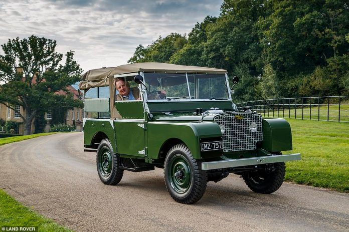 Ray Massey, editor of the Daily Mail Motoring, posing in an original Land Rover Series 1 model