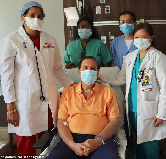 Cardiologist Dr Annapoorna Kini told Gulati that if he had waited just two more hours to go to the hospital, he would have died. Pictured: Gulati (center) with Kini (far left) and members of Mount Sinai's cardiology team
