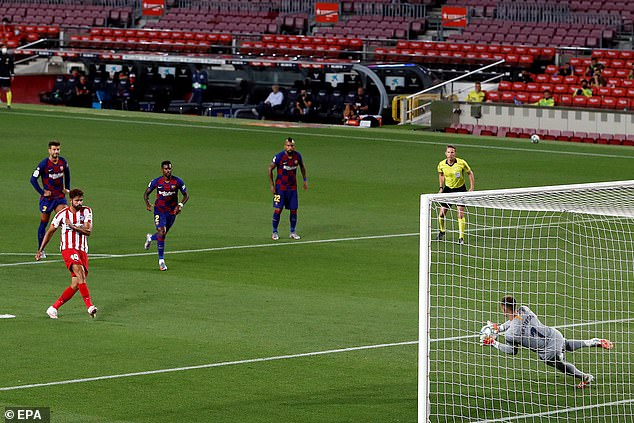 Ter Stegen throws himself to his left to save Costa's spot kick after advancing from his line