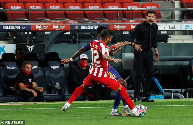 Atletico boss Diego SImeone gives instructions to his players in the top-of the table clash