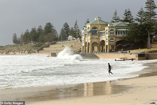 Perth's median house price fell by 1.1 per cent in June to $459,376. Pictured is the Cottesloe Beach pavilion