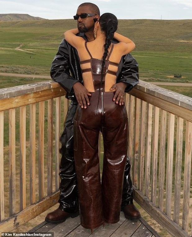 Romantic time: Kim and Kanye posed for some romantic couple photos on their land, serving wild west opulence in black and brown leather looks