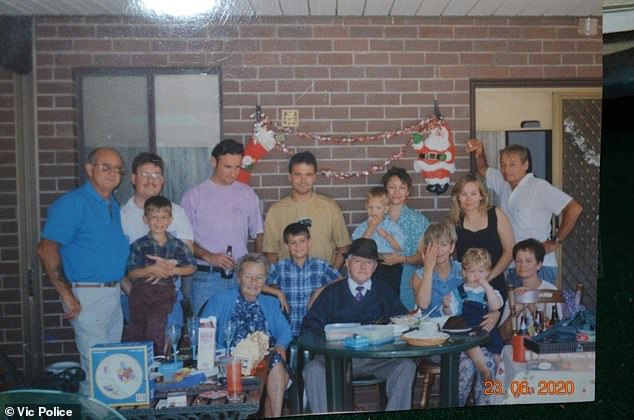 Shari's mother Sandra (seated in blue shirt) is holding Luke and her father, Tom is standing far right leaning against wall (next to Shari wearing black dress)