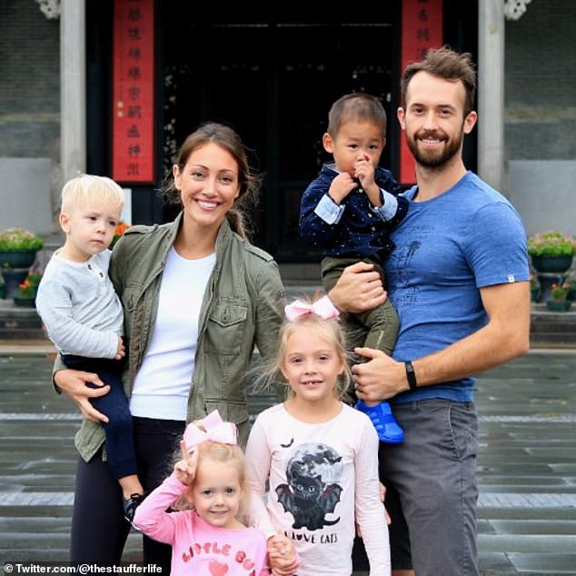 A redacted report on the investigation seen by Buzzfeed News said the little boy was 'very happy and well taken care of' by his new parents and that there were 'no signs of any abuse'.Myka and James Stauffer with their four biological children and Huxley.