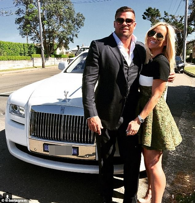 What once was: A suited Darren John Mohr and his bikini model ex-girlfriend Krissy Marsh with a white Rolls Royce prior to his Christmas Day arrest in 2016 after a flopped coke importation