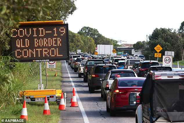 Traffic is seen on the Pacific Highway in New South Wales near the Queensland Border