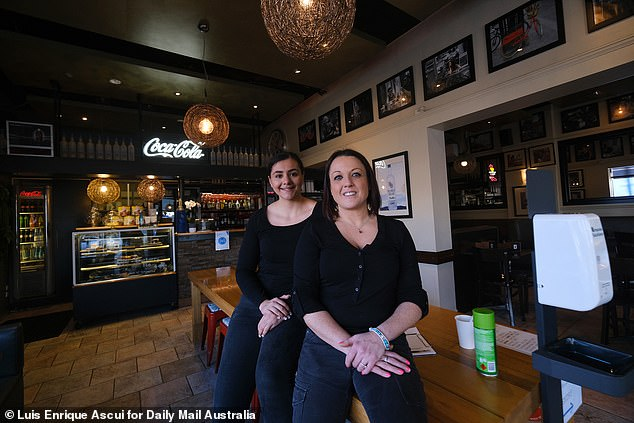 Victoria Agostino, who manages Mammalinas cafe, (right) andNiccola Nigro will be back at work just down the road. AN intersection is all that divides those that can open and close