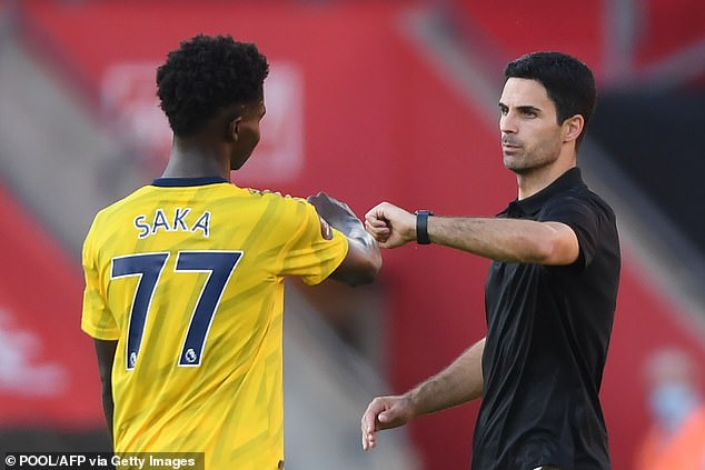 Gunners boss Mikel Arteta (R) is keen to keep Saka at the club and reward him with a new deal
