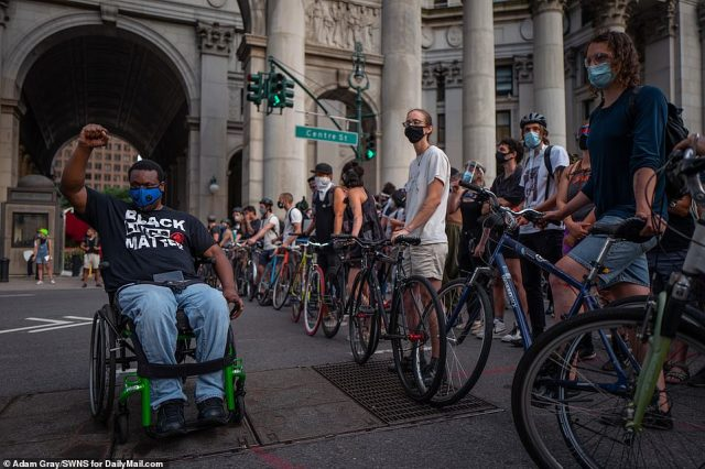 Protesters gather outside the New York City Municipal Building near City Hall Park to protest policing