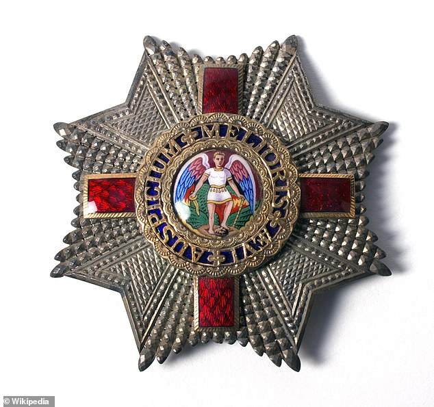The old design for the star insignia give to those appointed to the Most Distinguished Order of St Michael and St George. The design featured a picture of the Archangel Michael defeating Satan