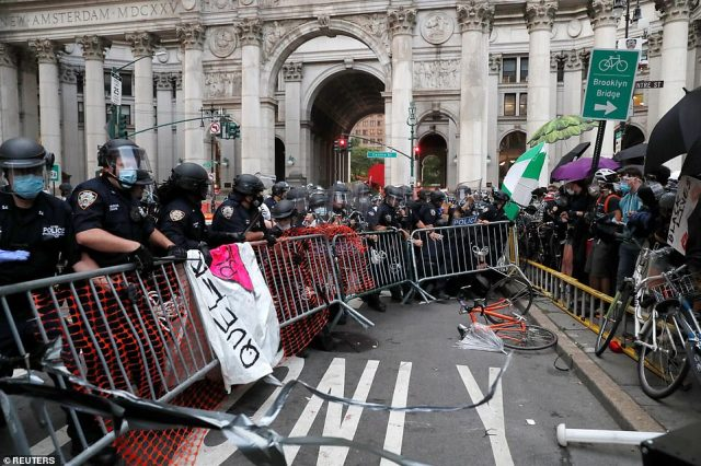 The cops removed the barricades the protesters had set up to push them back into the park and off of the street