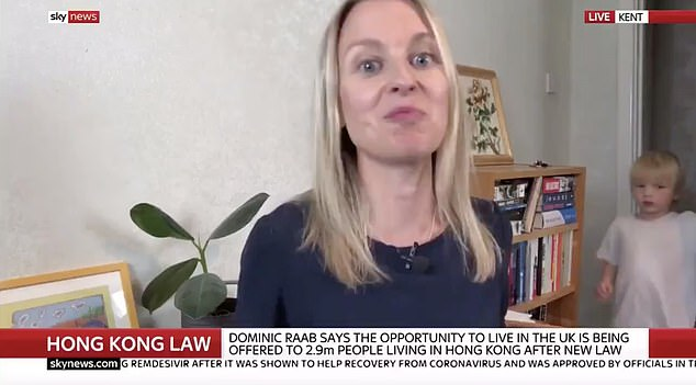 Journalist Deborah Haynes (pictured) , from Kent, was interrupted by her son during an interview for Sky News