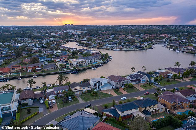 House prices in wealthy, waterfront suburbs of Australia's big cities are falling at a faster rate during the coronavirus downturn. Pictured is the Gwawley Bay section of Sylvania Waters in Sydney's Sutherland Shire, which suffered a 1.7 per cent property price fall in June - almost double the city-wide average of 0.8 per cent