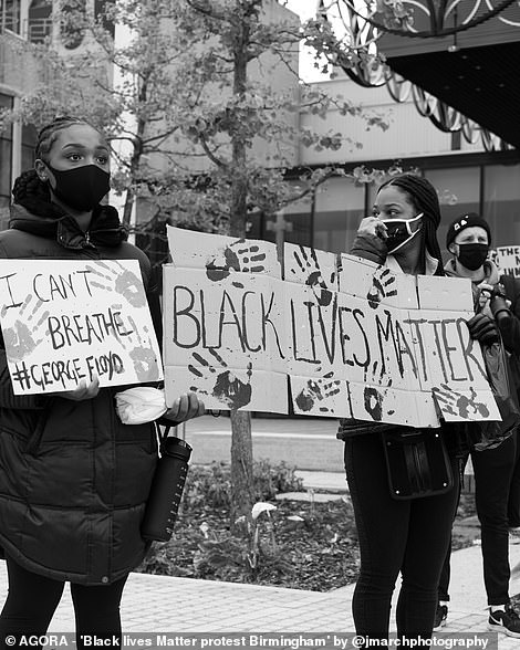 Pictured: Two women at a Black Lives matter march hold signs, one of which reads 'I can't breathe'