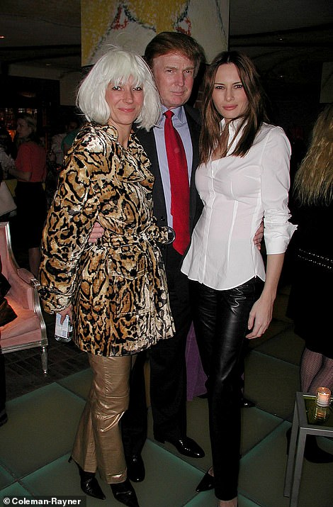 Donald Trump and his future wife Melania Knauss pose for a photo with the alleged accomplice of Jeffrey Epstein Ghislaine Maxwell at a Halloween party on the theme of prostitutes and pimps October 31, 2000